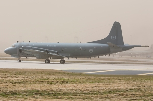 A Lockheed Orion CP-140 of the Royal Canadian Air Force, 140116, lines up to depart Lossiemouth during an intense sandstorm in 2013. Just visible in the background is the parking area for the Maritime Patrol Aircraft (MPAs) that take part in Joint Warrior. The usual mix includes USN P-3 and RCAF CP-140 Orions, but has included French, German, Norwegian and Brazilian Navy MPAs in recent years