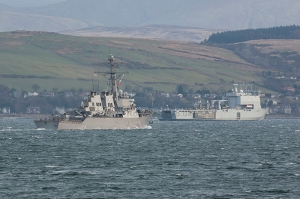 Arleigh Burke class Destroyer USS Ross (DDG 71) about to pass RFA Lyme Bay (L3007) of the UK Royal Fleet Auxiliary