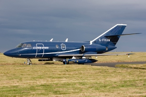 Cobham Aviation Falcon 20 G-FRAW taxies for take-off from RAF Lossiemouth during Joint Warrior 12-2 in 2012. The photo clearly shows all the additional pods these aircraft carry for replicating different aircraft, radars and weaponry