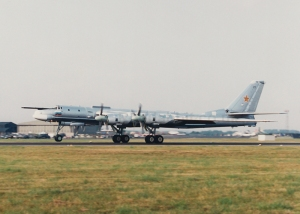 "With the breakup of the Soviet Union, aircraft of the Russian Air Force became popular targets for air show participants. The International Air Tattoo at Fairford, UK got the first bite in 1993 when Russia sent one Tu-95 and IL-78 refueller for the static display. In 1994 they did even better with a Russian Navy Tu-142M ""Bear F"" in the static and this Russian Air Force Tu-95MS ""Bear H"", 23 black, in the flying display. © Tony Roper"