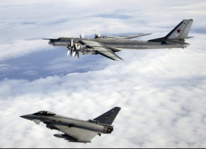 A Quick Reaction Alert (QRA) Typhoon F2 from Number XI Squadron at RAF Coningsby is pictured escorting a Russian Bear-H aircraft over the North Atlantic Ocean. QRA procedures entail aircraft being held at continuous ground readiness, so that they can take off within minutes - without pre-warning - to provide air defence. (Photo courtesy of UK Ministry of Defence Crown Copyright Photo Service ©2008 Crown Copyright